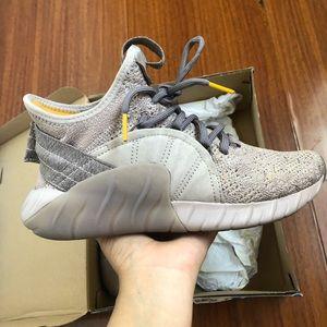 Adidas tubular rise in beige